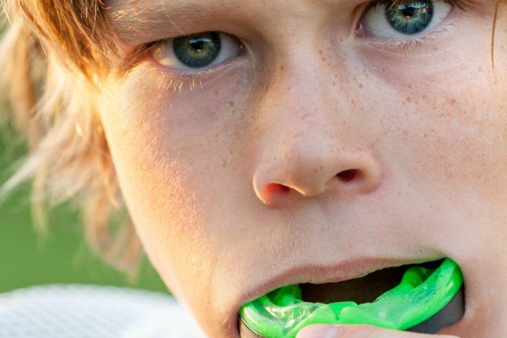 Boy with custom mouthguard